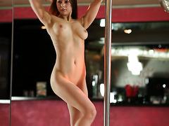 Gorgeous Ukrainian babe Darisha is rehearsing her striptease dance