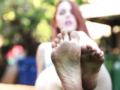 Spanish babe Amarna Miller shows her lovely feet in a garden