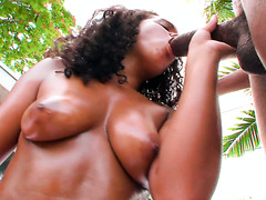 Tanned Latina gets oiled and penetrated by big black cock outdoors