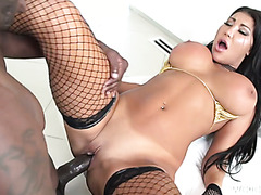 Nadia Villanova shows off her massive tits and rides mandingo to exhaustion