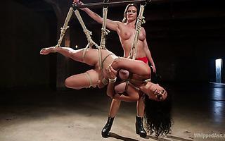 Extreme lezdom punishment of thick Izamar Gutierrez by filthy mistress Ariel X
