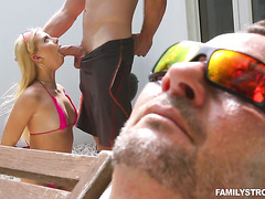 Riley Star fucks uncle's stepson by the pool next to sleeping uncle