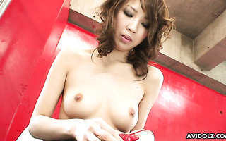 Appetizing Japanese chick Mika Ito gently caresses her shaved coochie in solo