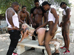 White blondie Bella Jane endures gangbang with five big black cocks