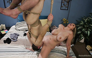 Mean dame Lisa Ann gets licked by slave in suspended bondage