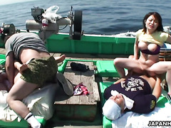 Group sex on a fishing boat with busty Japanese girls