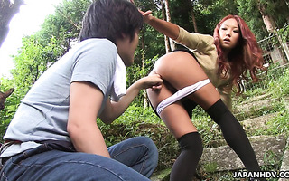 Ai Mizushima lets nerdy coed fuck her tanned Asian ass in the woods