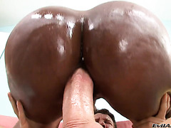 Superb black booty of Nyomi Banxxx is oiled and filled with white meat