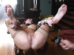Redhead slave Tana Lea is bondaged and punished by fat dick