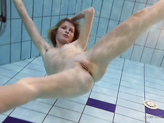 Slender Nastya shows off her nude body swimming under the water