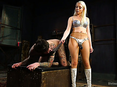 Nasty mistress Lorelei Lee strapons her slave and tortures his manhood