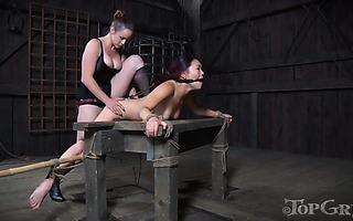 Submissive Asian girl Lea gets straponed by her mistress Bella Rossi