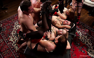 Group of tied up submissive whores get fucked at wild party