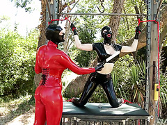 Unique mistress Latex Lucy spanks her latex coated slave Paige Delight