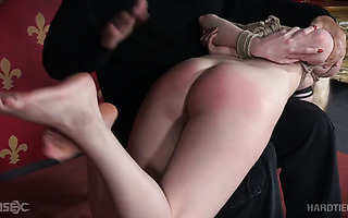 Helpless April Rain gets spanked and toyed with magic wand