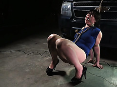 Siouxsie Q gets tied up tight in a garage and tortured & toyed