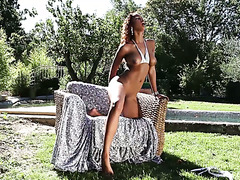 Graceful Cuban seductress Katia De Lys masturbates by the pool