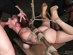 Tied up with rope Bella Rossi gets smashed by two reckless mofos